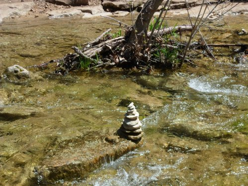 cairn in the middle of the creek