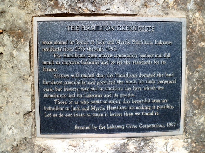 plaque embedded in a large boulder on the trail